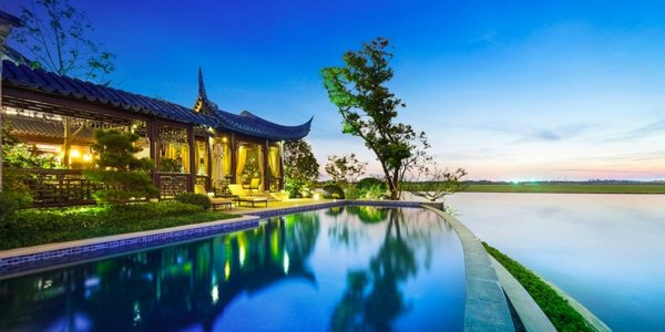 A lakeside swimming pool offers spectacular views of the lake and, in the distance, the city of Suzhou.